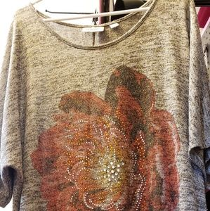 Sparkly Gray  Blouse with a flower on the front.
